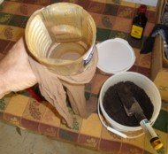 I use a 2 qt. juice container as a funnel to get my manure into my tea bag, a nylon hose.